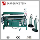 Automatic spring assembler-- automatic bonnell spring mattress assembler