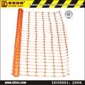 de plástico de color naranja de seguridad advierten de la cerca neto
