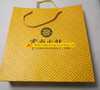 paper gift bag with cord handles and double reinforced cardboard fold