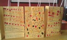 Hand drawing kraft paper bag by kid's idea and creation