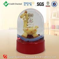 Cute plastic musical snow globe