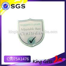 Shield shaped certified metal badge for adjustable base from Leggett& platt company
