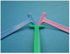 Soft rubber handle tongue scraper/cleaner