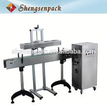 High speed filling line continuous aluminum foil sealer