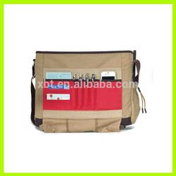 Cotton computer messenger bag with felt-lined laptop pocket