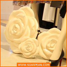white large artifical craft rose flower in window shop decoration