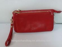 Classic designgenuine leather clutch ,top zip closure ,zip closure inside and slip pockets cheap price good quality cards clutch