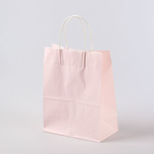 Eco-friendly pink paper bag with handle