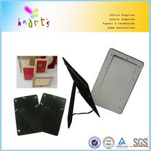 black framed board holding pictures