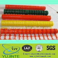 orange / yellow plastic safety fencing net