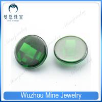 Flat bottom checkerboard cut green CZ stone in round shape