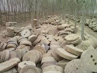 old antiqued stone millstones