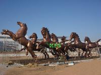Bronze sculpture of horses running in garden