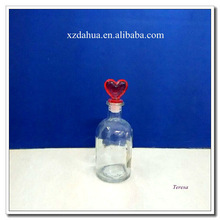 glass perfume bottle with heart shaped glass stopper