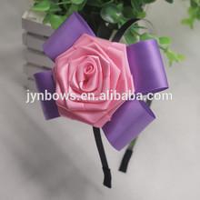 Beautiful headband embellished with big pink flowers