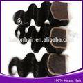 Caliente nuevos productos para el 2015 100% del pelo humano superior de mongolia rizado rizado cierre medio parte rayita