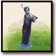 brass child playing tennis statue
