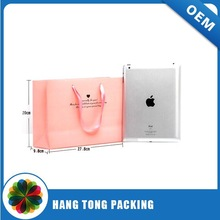 Pink paper bag with handles for garment, shoes bag with handles