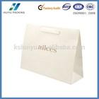 White kraft paper drawstring bag with white ribbon handles for shopping