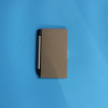 with ballpen and self-Adhesive sticky note paper memo pad
