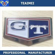 Nissan C210 Skyline blue GT badge chrome emblem