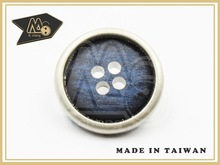 brown plastic button of manufacturer for clothes