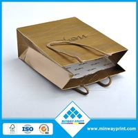 cheap luxury packaging bag gold color paper shopping bag gift bag with cotton rope handle sale at fancy price Shenzhen factory