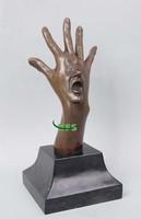 Bronze abstract hand face sculpture