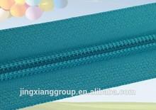 Guangzhou JingXiang Nylon Coil Zipper Slider Rubber Zipper Puller For Hard Plastic Luggage
