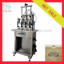 four nozzles vacuum liquid filling machine