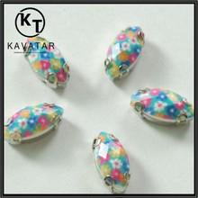 Beautiful print rhinestone/jewelry with metal setting for sew on