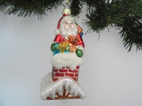 stand on snow house carry a baby bear with santa glass ornament for christmas decoration