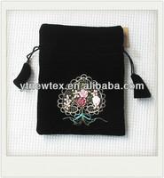 velvet clutch pouch bag with ribbon flower design