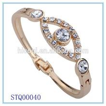 2015 New Fashion Special Gold Slender Angle Eye Carve Crystal Chain Link Bangle Bracelet For Women