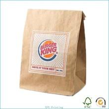 convenient brown kraft paper bag with die-cut handles for fast food take away