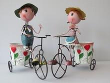 YiWu directly supply beautiful metal wall art Garden Metal Doll With Flower Pots