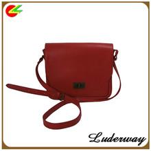 Vintage leather messenger bag with metal lock