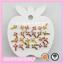 a cross earring for children