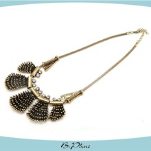Metal necklace with antique gold necklace statement