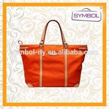 OEM low price fashion week pvc handbag