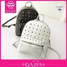 2015 manufacturer alibaba travel bag fashion travel leather rivets students backpack