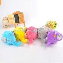 colourful mini plush elephant with flower