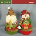 Árbol de navidad de interior decoración de papá noel y muñeco de nieve de navidad decoración de la mesa con la bolsa de arena