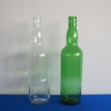 Clear and green color 750ml bulk rum glass bottle