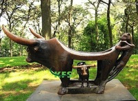 Bronze abstract cows in forest sculpture