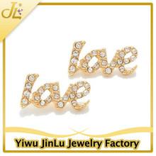 Gold crystal love word earrings