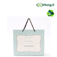 Glossy Finishing PP Rope Big Size Cloth Package Gift Paper Bag
