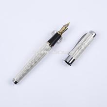 silver metal fountain pen