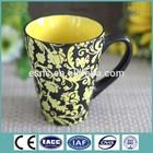 Quality most popular cheap ceramic Inside yellow glazed mug pottery mug with flower embossment