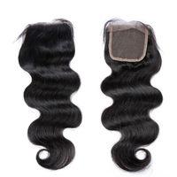 Natural color 4x4 lace closure body wave brazilian hair closure